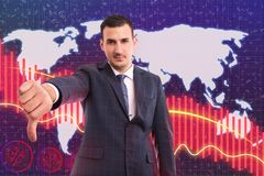 Man showing thumb down as drop in stock market. Man wearing black suit showing thumb down gesture with serious expression as drop in business stock market with stock images