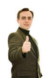 Man showing thumb-up. Isolated studio shot. Royalty Free Stock Image