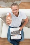 Man Showing Thumb Up With Laptop Stock Image