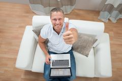 Man Showing Thumb Up With Laptop Royalty Free Stock Photography
