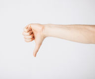 Man showing thumbs down Royalty Free Stock Photography