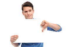 Man showing thumbs down with blank board Royalty Free Stock Images