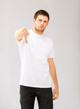 Man showing thumbs down Stock Photos