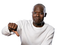 Man showing thumbs down sign. Portrait of a displeased afro American man showing thumbs down sign in studio on white isolated background Stock Photography