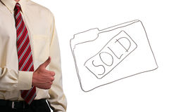 Man showing thumbs up. Man in a shirt and a tie showing thumbs up while standing next to a drawing of a folder. Add your text to the folder Royalty Free Stock Photos
