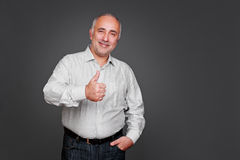 Man showing thumbs up sign Stock Image