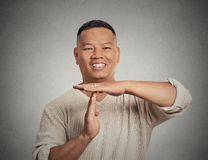 Man showing time out gesture Stock Photos