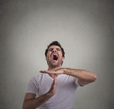 Man showing time out hand gesture, frustrated screaming to stop Stock Photography