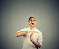 Man showing time out hand gesture screaming to stop Stock Images