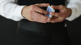 Man showing trick with playing cards Stock Image