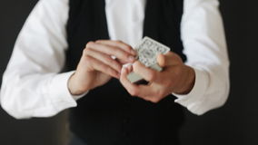 Man showing trick with playing cards Stock Photos