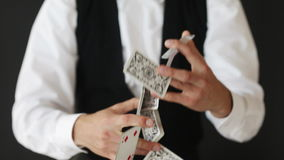Man showing trick with playing cards Royalty Free Stock Photography