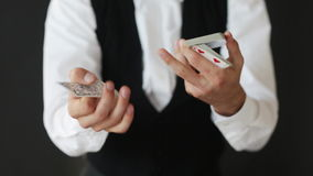 Man showing trick with playing cards Stock Photo