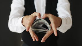 Man showing trick with playing cards Royalty Free Stock Photo