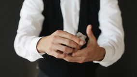 Man showing trick with playing cards stock video