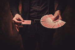 Man showing tricks with cards Stock Photography