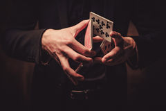 Man showing tricks with cards Royalty Free Stock Images