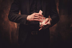 Man showing tricks with cards Royalty Free Stock Photos