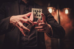Man showing tricks with cards Royalty Free Stock Image