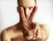 Man showing two fingers. On a white background Royalty Free Stock Photo