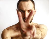 Man showing two fingers. On a white background house Royalty Free Stock Photo