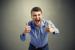 Man showing two thumbs up Stock Photo