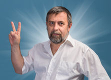 Man in  showing victory sign Royalty Free Stock Photography