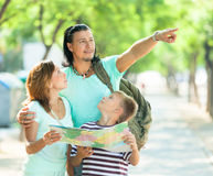 Man showing the way  for family at park Royalty Free Stock Photography