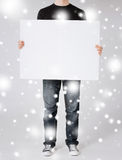 Man showing white blank board Royalty Free Stock Photography