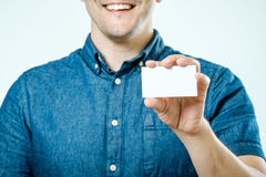 Man showing white blank business card isolated. Focus on card Stock Photo