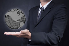 Man showing wireframe globe Stock Photo