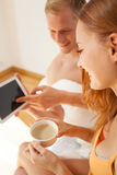 Man showing woman something on the tablet Stock Photography