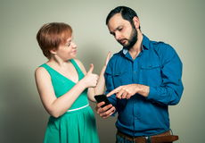 Man showing woman something Stock Images