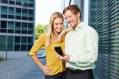 Man showing woman website on a smartphone Stock Photography