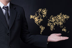 Man showing World map made with dollar sign Royalty Free Stock Photography