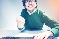 Man showing yes gesture and smiling Royalty Free Stock Photography