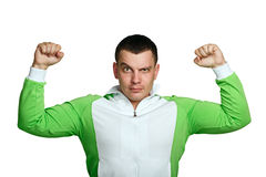 Man shows biceps. Man in sports suit shows biceps, isolated on white background Royalty Free Stock Photo