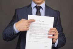 The man shows on a contract Royalty Free Stock Image