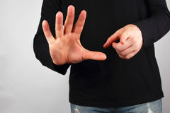 Man shows different hand gestures Stock Photography