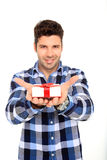 Man shows a gift box. Handsome man portrait with a gift in his hands Stock Photography