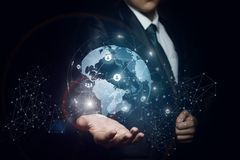 Man shows a global business network. Man shows a global business network on dark background Stock Photo