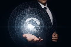 Man shows a global network in hands . stock photos