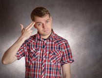 Man shows headshot with his fingers. Royalty Free Stock Images