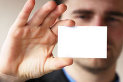 Man shows his business card Stock Image