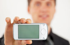 Man shows LCD screen mobile phone Stock Photography
