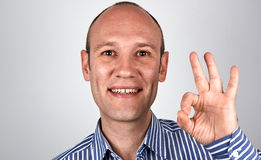 Man shows OK sign. With positive emotion Royalty Free Stock Photography