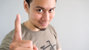 Man shows one finger. Royalty Free Stock Image