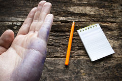 Man shows the problem lefties dirty hand after writing closeup Stock Image