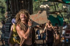 Man shows a sign on a cardboard in which you can read you`re beautiful at the Lost Theory psytransce music festival