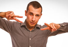Man shows sign hippie freedom peace, Royalty Free Stock Photography
